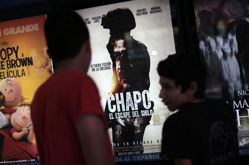 People view the poster of the film, El Chapo - The Escape of the Century, at a cinema in Mexico on Jan 15, 2016.