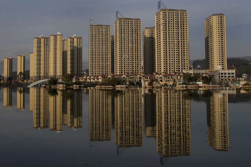 Newly constructed residential buildings at Kunming Waterfall Park, China.