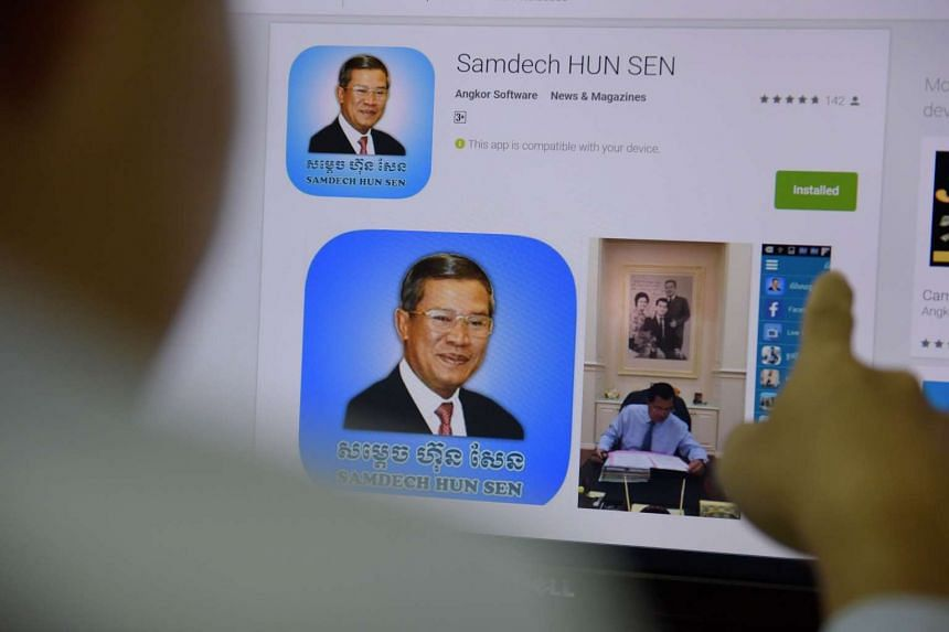A man looking at a page of Cambodian Prime Minister Hun Sen's app on a computer in Phnom Penh on January 12, 2016. It is part of a social media blitz selling the strongman's cuddlier side as he seeks to extend a 30-year grip on power.