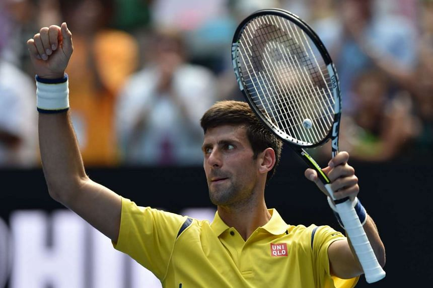 Serbia's Novak Djokovic celebrates after victory in his men's singles match against South Korea's Chung Hyeon on Jan 18, 2016.
