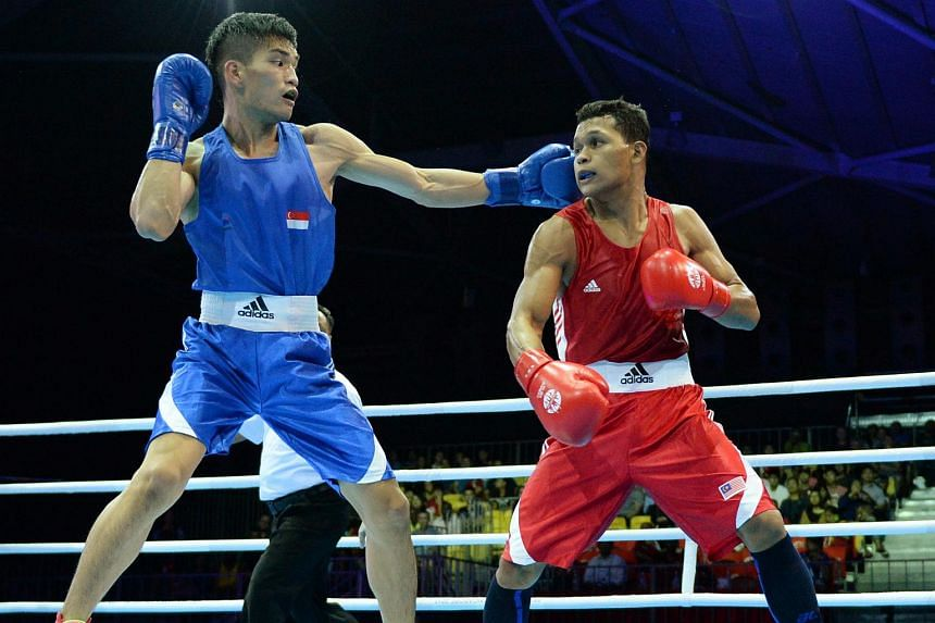 Singapore's Leong Jun Hao (in blue) in action during the SEA Games 2015 men's light welterweight quarter-finals.