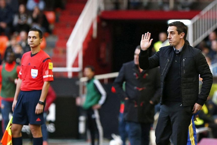 Valencia English head coach Gary Neville (right) reacts during the Spanish King's Cup on Jan 6, 2016.