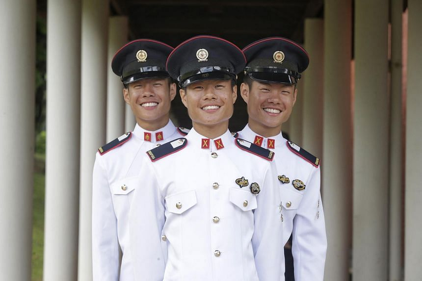 (From left) Identical triplets Phuah Wei Yuan (combat service support), Phuah Wei Ke (infantry), and Phuah Wei Deng (infantry) have graduated from the 38-week OCC.