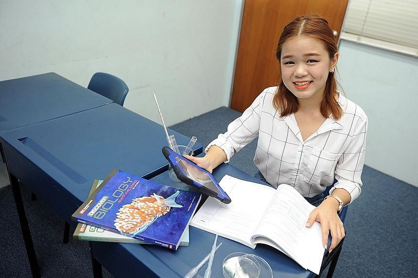 Hong Qi, 17, attended classes at private school Penciltutor before re-sitting her O-level exams.