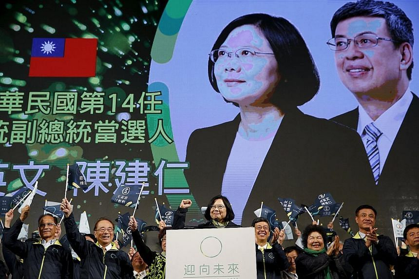 DPP presidential candidate Tsai celebrating Saturday's election victory at the party's headquarters in Taipei. A political limbo ensues as she will be sworn into office only on May 20.