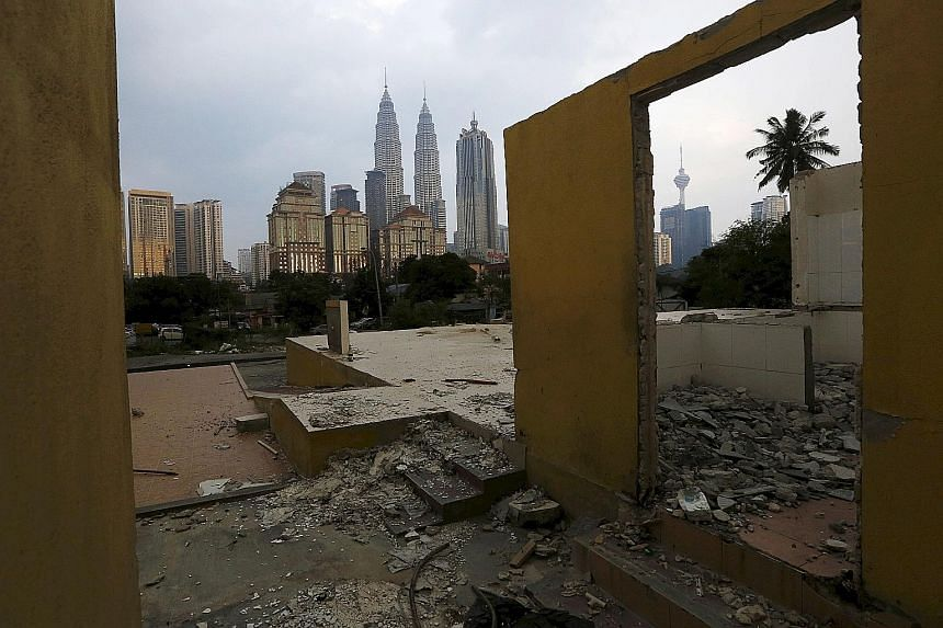 A forlorn prospect from an abandoned restaurant in Kuala Lumpur of the capital's twin towers - built in the 1990s with Petronas' oil wealth. Malaysia will announce a Budget revision on Jan 28 as the government said each US$1 drop in oil prices slashe