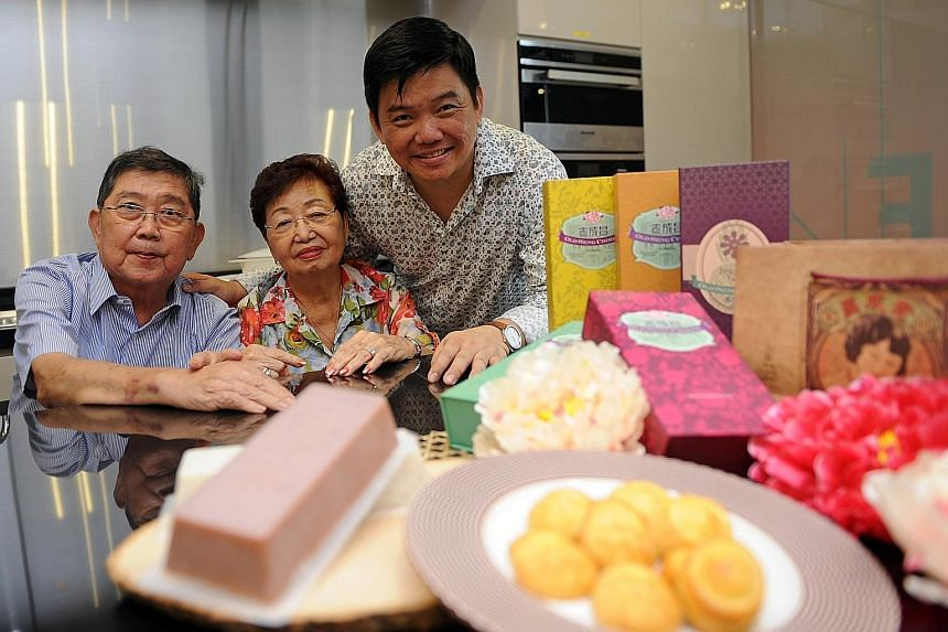 Former Bakerzin founder Daniel Tay (right) with his parents, Mr Tay Yam Choong and Madam Lim Ai Kiang, and some of the confections that are being sold at online bakery Old Seng Choong.