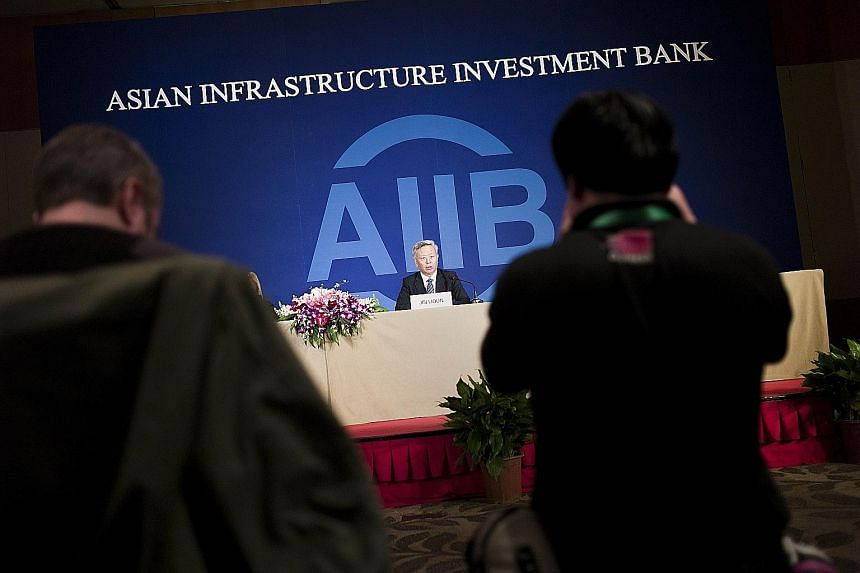 AIIB president Jin speaking to journalists in Beijing yesterday. His pledge comes amid concerns that the AIIB might fail to keep global standards in environmental, labour and anti-corruption protection.