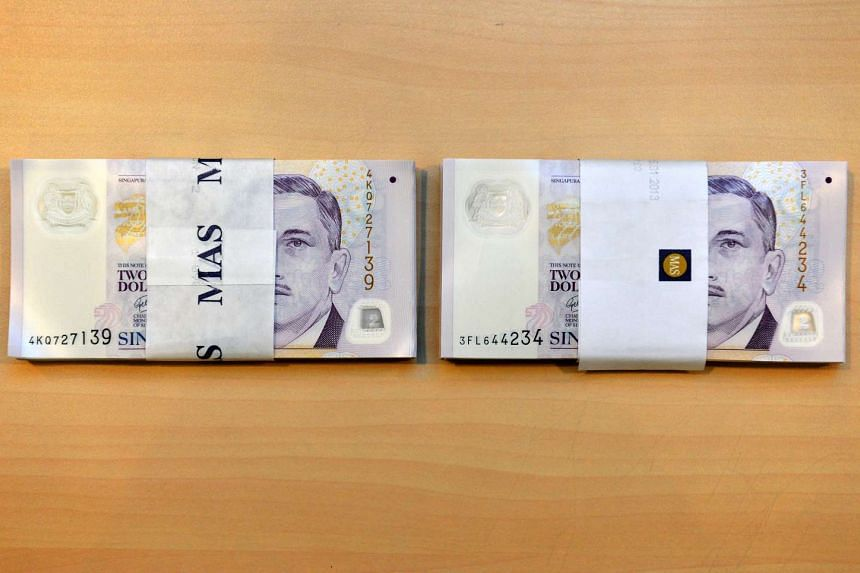 """A stack each of new $2 notes (left) and """"good-as-new"""" notes."""
