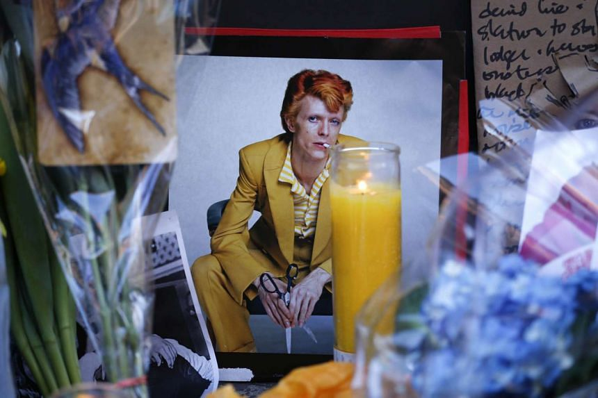 A poster of David Bowie at a memorial outside the apartment building he lived in in New York, where he died on Jan 11.