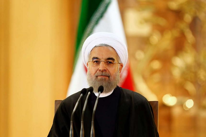 Iranian President Hassan Rwohani speaks during a press conference in Teheran on Sunday, Jan 17, 2015.