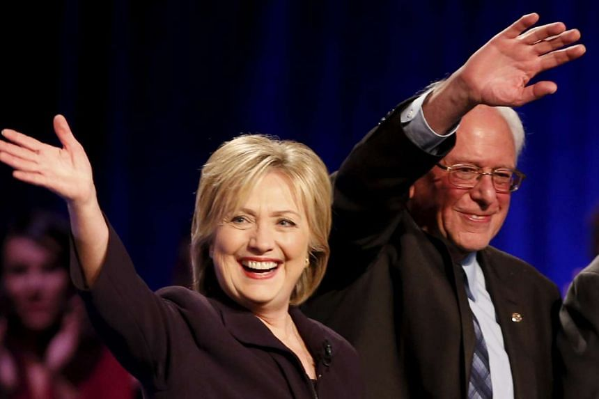 Democratic presidential candidate Hillary Clinton (left) has attacked top challenger Bernie Sanders (right) on being too lax on gun control.