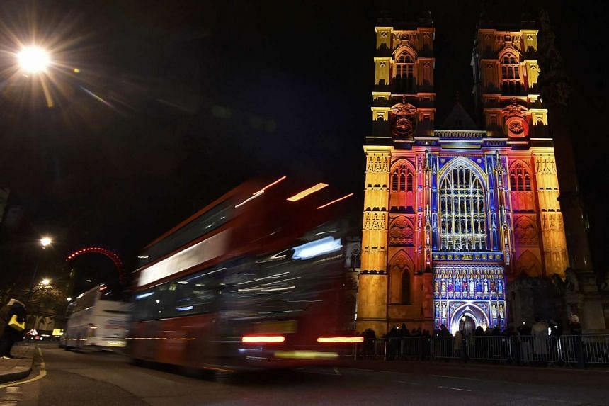 """Westminster Abbey (above) is lit up with """"The Light of the Spirit"""" by French artist Patrice Warrener as part of the """"Lumiere"""" – in which London's most famous landmarks are illuminated."""