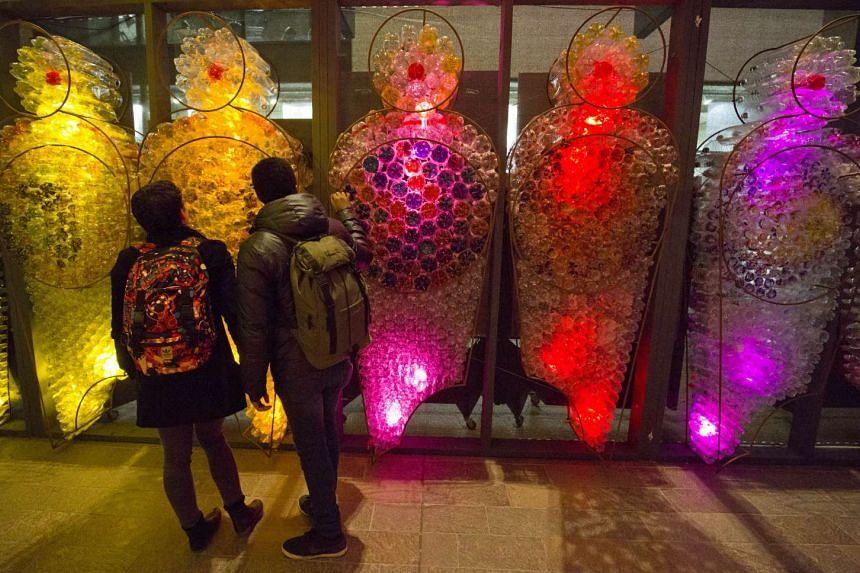 Visitors taking in British artist Mick Stephenson's works of light (above) and taking part in a light art installation during the four-day tourism-boosting Lumiere festival, which ended yesterday.