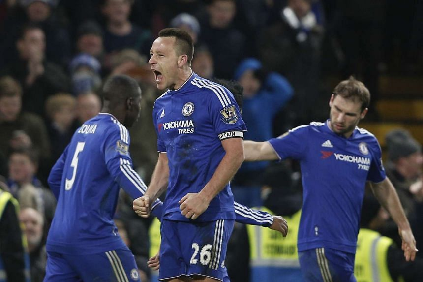 John Terry (centre) celebrates scoring an equalising goal during the match between Chelsea and Everton on Jan 16, 2016.