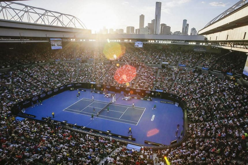 A packed Rod Laver Arena with the skyline of Melbourne, at the Australian Open Grand Slam tennis tournament on Jan 18, 2016.