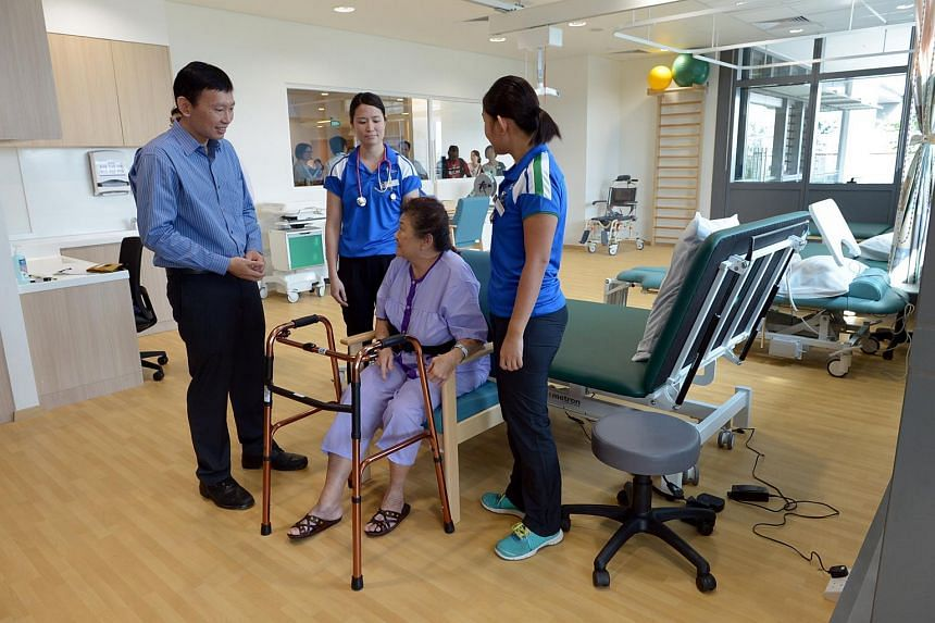 Minister of State for Health Chee Hong Tat talking to a patient during the opening of Yishun Community Hospital on Dec 28, 2015.