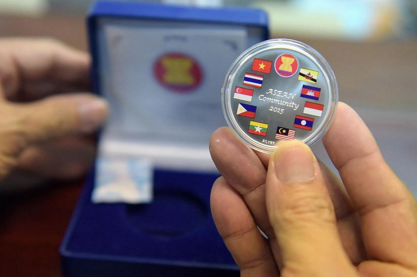 A commemorative coin with the flags of Asean member countries at the National Bank of Cambodia on Dec 25, 2015.