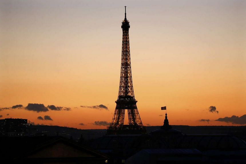 The Eiffel Tower in silhouette  at sunset on a winter day in Paris on Jan 15, 2016.