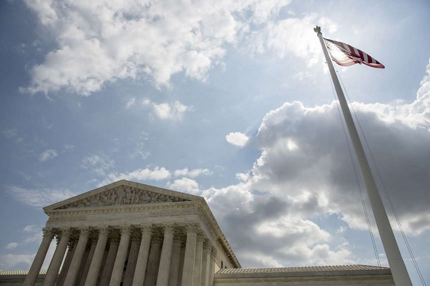 The US flag flies in front of the Supreme Court in Washington.