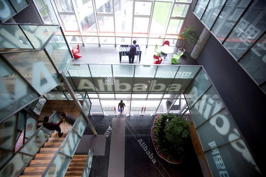 People walk through Alibaba Group Holding's headquarters in Hangzhou, China.