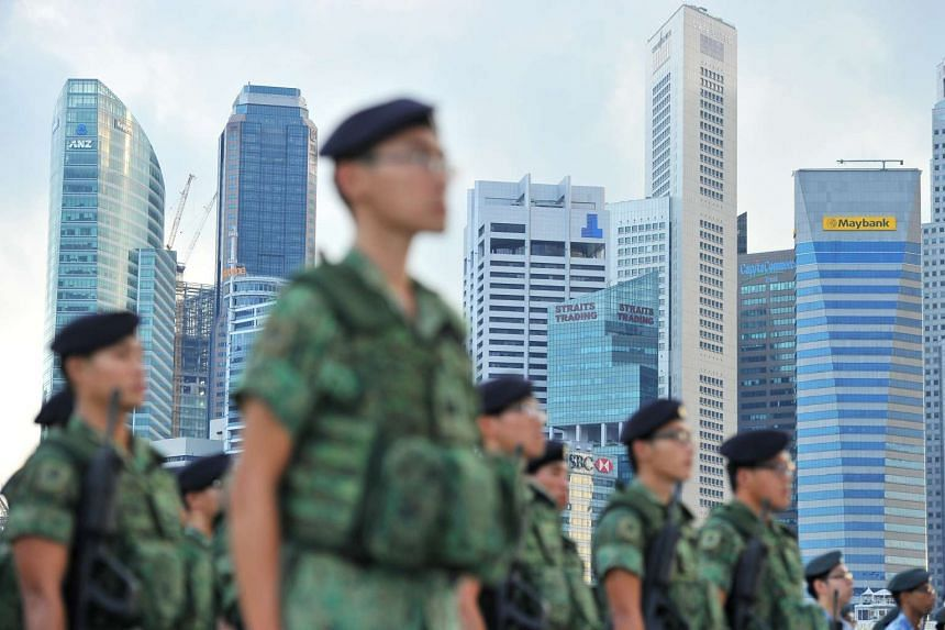 Singapore Armed Forces servicemen standing at attention at The Float@Marina Bay on July 19, 2014.