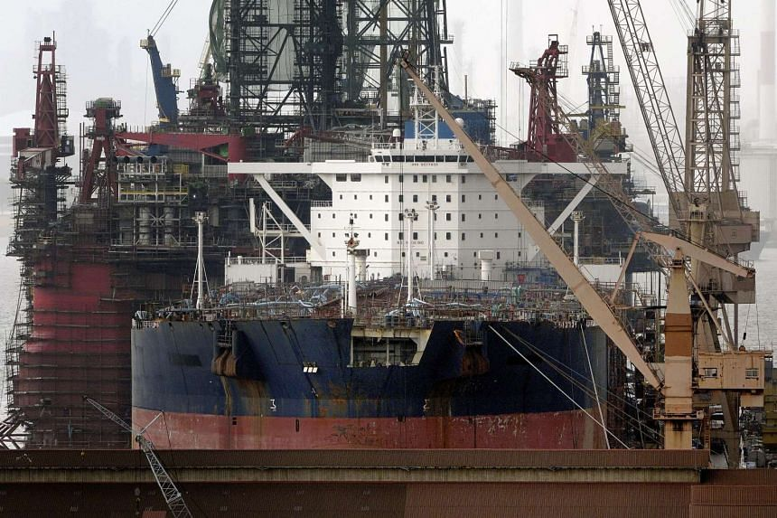 An oil tanker and an oil rig undergo repair at the Jurong Shipyard of Sembcorp Marine Ltd.