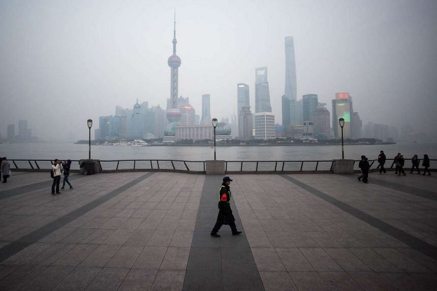 A security guard walking at the bund near the Huangpu river in Shanghai on Jan 18, 2016.