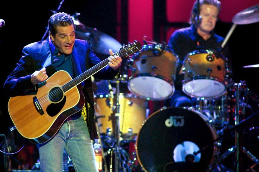 Glenn Frey, with Don Henley in the background, performs the song New Kid In Town during a sold-out show on the band's Farewell I tour at the MGM Grand Garden Arena in Las Vegas, Nevada in this Aug 9, 2003, file photo.