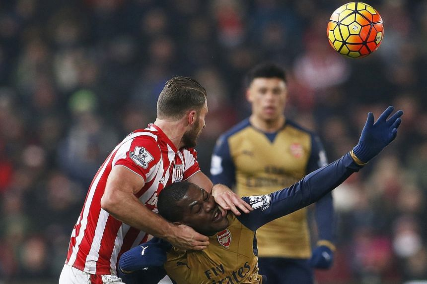 Arsenal's Joel Campbell (in gold) challenging for the ball with Stoke's Erik Pieters during the 0-0 draw on Sunday.
