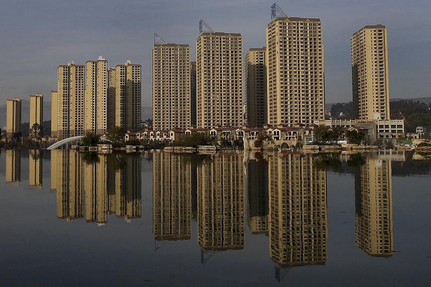 Newly-constructed residential buildings in Yunnan province in China. As part of the country's easing measures, the central bank has reduced interest rates six times since November 2014, along with a cut in reserve requirements for all banks, helping