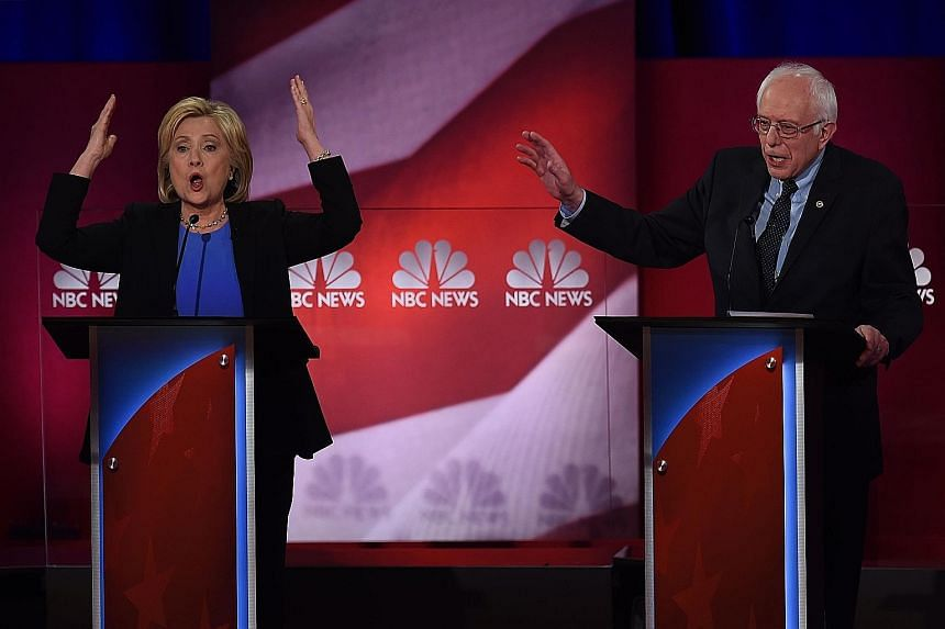 Mrs Clinton attacked Mr Sanders' healthcare plan and on gun control, while he accused her of being cosy with Wall Street.