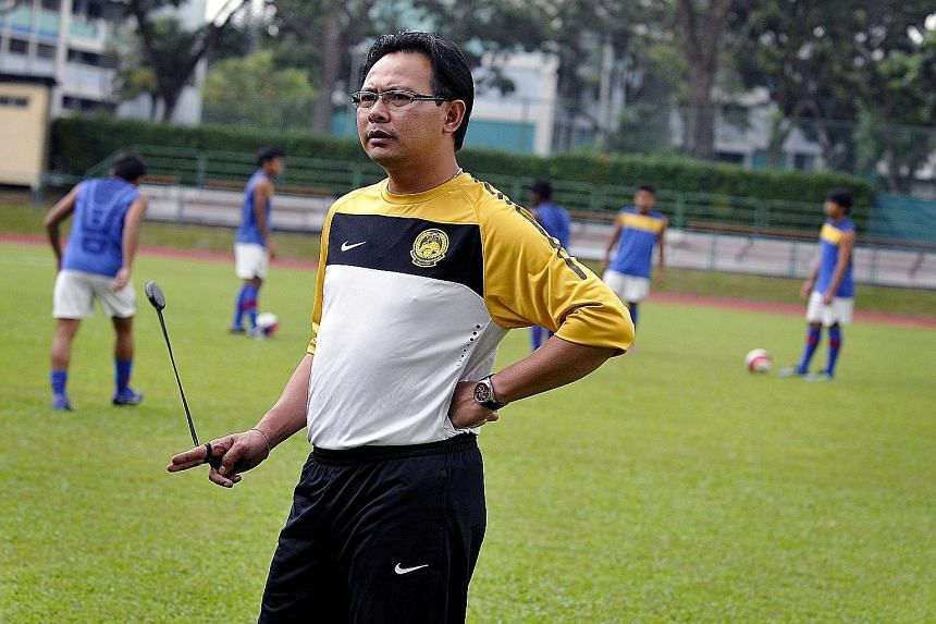 Ong Kim Swee taking charge of a training session when he was the coach of Harimau Muda A. The 45-year-old will take up a new role as his nation's coach and seek to improve Malaysia's dismal position of 171 in the Fifa rankings.