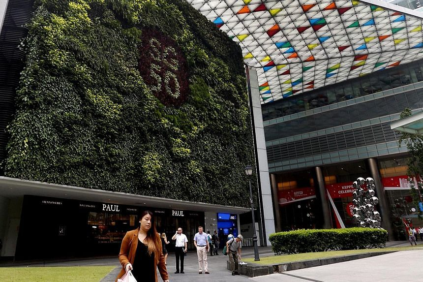 Higher revenue from Ocean Financial Centre (left) and Bugis Junction Towers sent Keppel Reit's property income up 1.1 per cent to $42.8 million and net property income ahead 1.5 per cent to $34.8 million.