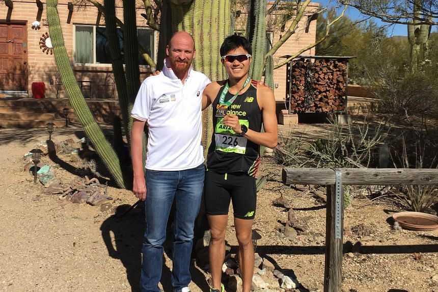 Mok Ying Ren with his coach Lee Troop. On Sunday, the Singaporean clocked a new national best time of 1:07:08 at the Arizona Rock 'n' Roll Half Marathon. He aims to qualify for the Rio Games by July 11.