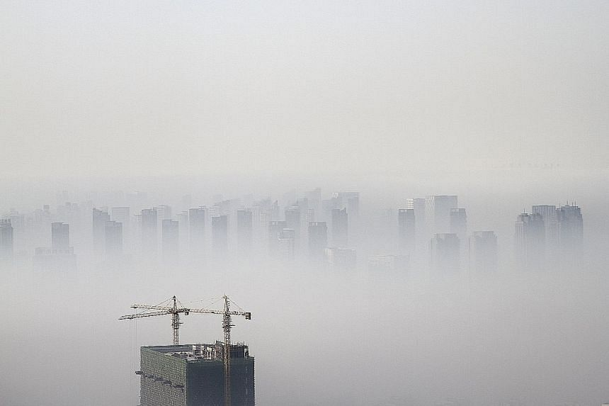 The skyline in Shenyang, in China's Liaoning province, shrouded in smog in this 2014 file photo. Outdoor air pollution kills more people in China than anywhere else, with 1.4 million deaths annually.