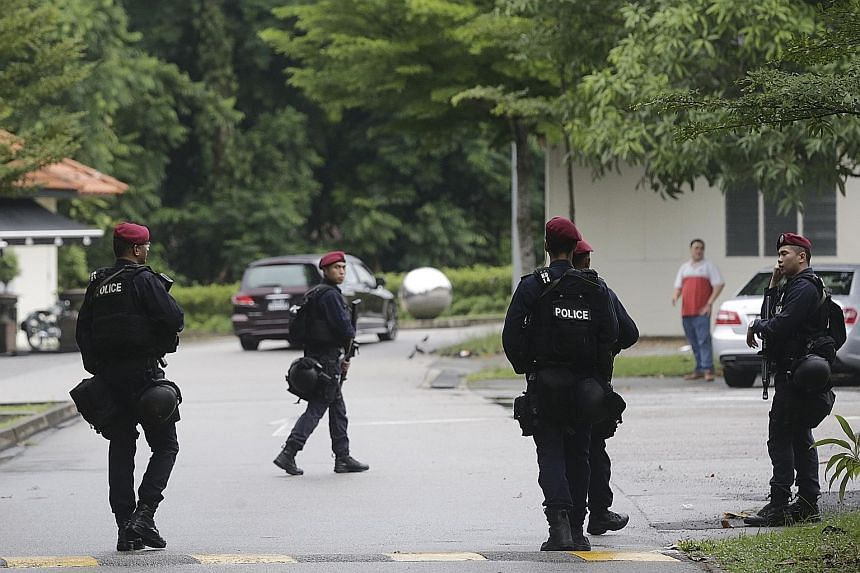 """Security personnel on patrol in Dempsey Road in November last year. Beyond its investments in hardware and capabilities, the Government will also look at ways to strengthen society's resilience - a """"key ingredient"""" in national security, says Deputy P"""