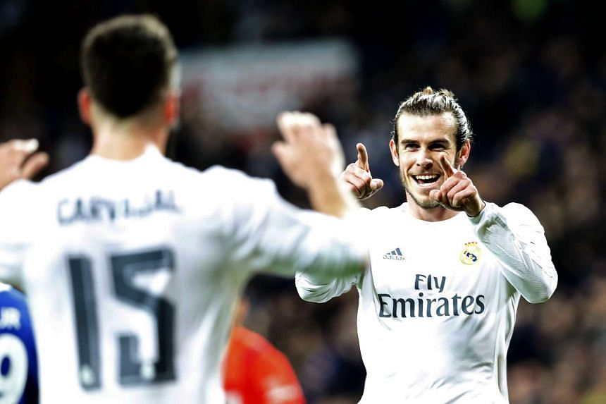 Bale (above right) limped off after scoring his 11th goal in eight games on Sunday.