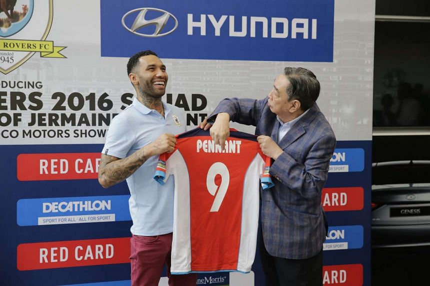 Jermaine Pennant is presented with his Tampines Rovers jersey by club advisor Teo Hock Seng at Komoco Motors on Jan 19.