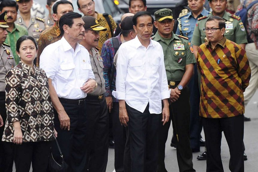 Indonesian president Joko Widodo (centre) visiting the site of a bomb blast in Jakarta on Jan 14.