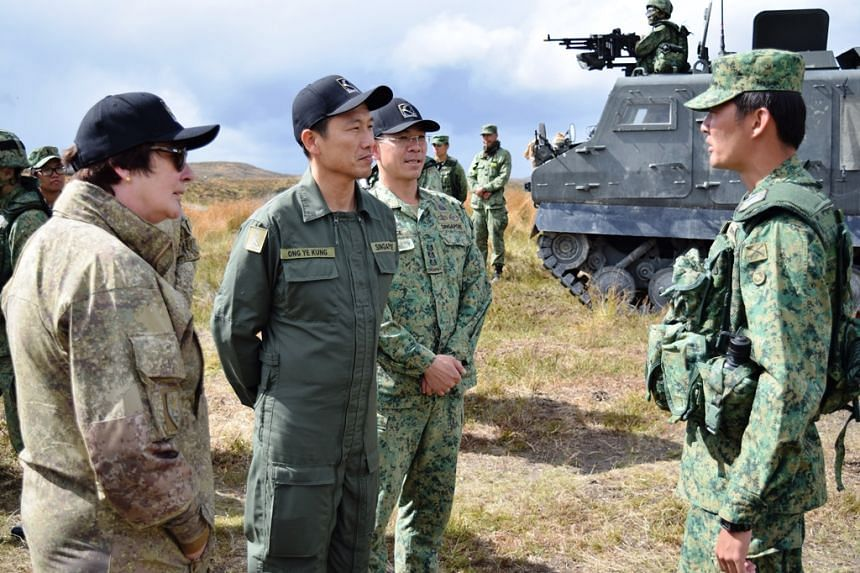 Senior Minister of State for Defence Ong Ye Kung (second from left) and New Zealand Secretary of Defence Helene Quilter (left) receiving a brief on Exercise Thunder Warrior 16.