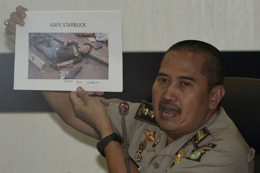 Jakarta Police medical division chief officer Musyafak shows a photo of suspected dead militant identified as Afif, alias Sunakin, at police headquarters on Saturday, Jan 16.