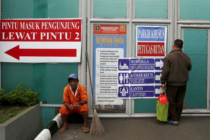 A man stands in front of the visitors' gate of Cipinang prison in Jakarta on Sunday, Jan 17.