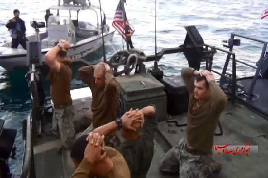 American sailors put their hands on their heads after they were captured by the Iranian Revolutionary Guard Corps on Jan 12.