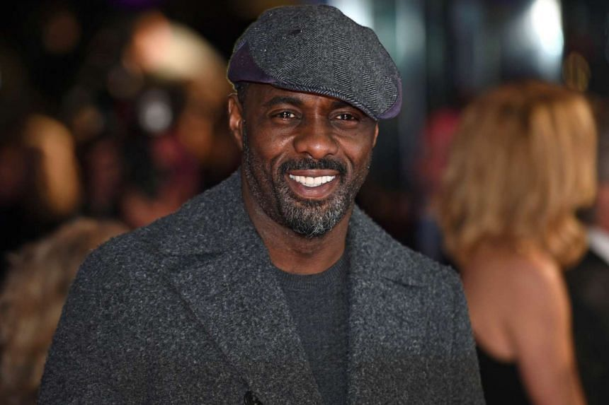 British actor Idris Elba poses for photographers ahead of the World Premiere of The Gunman in London on Jan 16, 2015.
