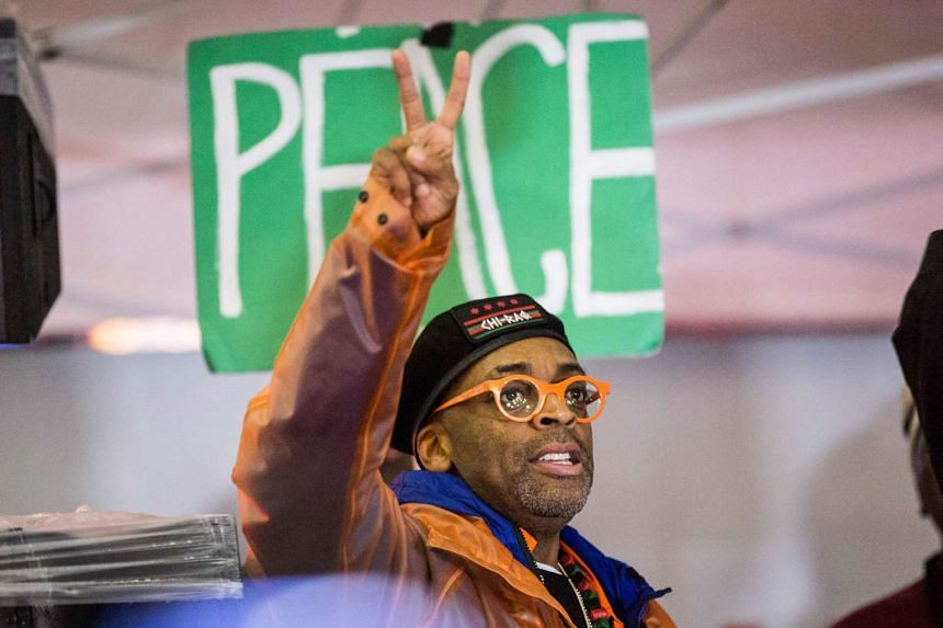 Film-maker Spike Lee shows a peace sign after leading a march calling for an end to gun violence on Dec 1, 2015 in New York City.