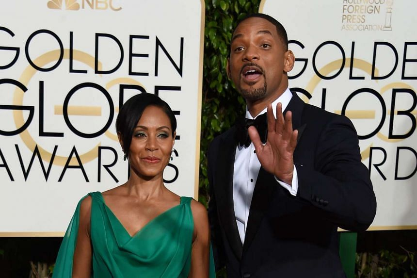 Jada Pinkett Smith and her husband Will Smith arrive for the Golden Globe Awards on Jan 10 at the Beverly Hilton Hotel.