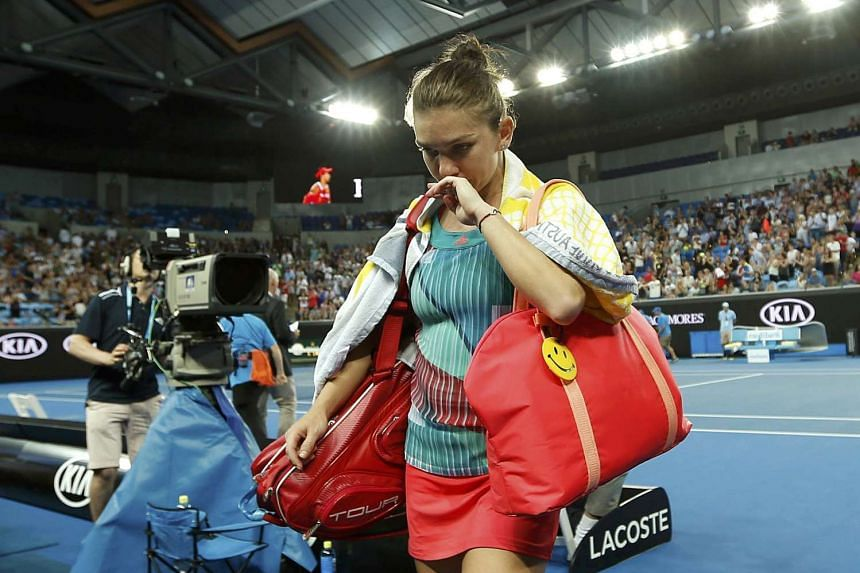 Simona Halep walks off the court after losing her first round match against China's Zhang Shuai at the Australian Open.