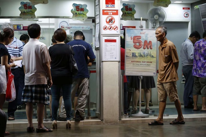 People queuing up at a Singapore Pools outlet in Toa Payoh in 2014.