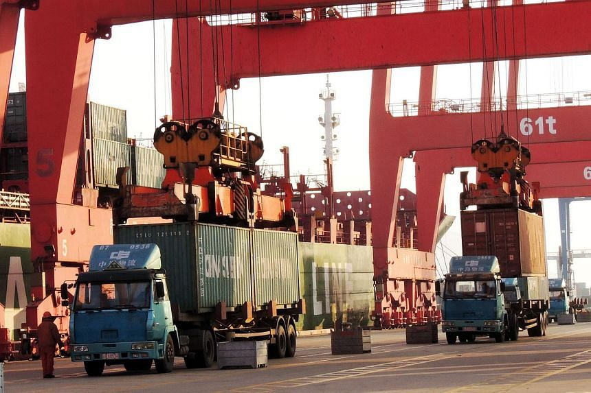 Containers are transported at a port in Lianyungang, eastern China's Jiangsu province on Jan 19, 2016.